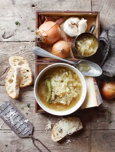 A small knob of butter  5 Large brown onions, thinly sliced  2 Bay leaves  A few sprigs of fresh thyme  2 Garlic cloves, finely chopped  A splash of dry sherry  500ml Beef or vegetable stock  2Tsp mustard powder  Salt and pepper  1 ciabatta loaf, sliced  Finely grated gruyere cheese