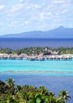 Some of the overwater bungalows in Bora Bora, French Polynesia. Go on island excursion around this beautiful island.