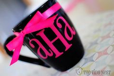 Apply vinyl letters and add ribbon to transform a cheap dollar store mug into a personalized gift!
