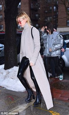 Hailey still looked stylish on her day off in wet-look leggings teamed with a taupe jumper and matching floor-length cardigan