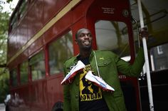 Jamaican sprinter Usain Bolt hops a ride on one of London's famous double-decker buses.  (Photo: DYLAN MARTINEZ / Reuters) #NBCOlympics
