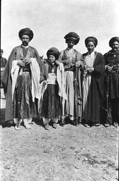 """Persian Kurds. """"The horsemen came galoping [sic] down to me - not to demand my money or my life, but because they were most anxious to be photographed too. It is a passion with them. I was eager to oblige for they were a fine set of ruffians, very handsome and bristling with arms."""" March 1911, Gertrude Bell Archive, Newcastle University"""