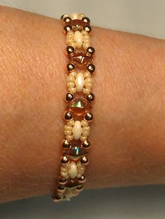 """Diamond Duo """"Trestle"""" from (around the beading table) I used Old Bourbon diamond duos,super duos in orange luster, copper rounds in 3mm and 11's in light caramel."""