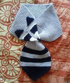 Stricken What a cute knitted skunk animal scarf! This looks like it could be converted to… – Stricken Diy Crochet And Knitting, Crochet Quilt, Knitting For Kids, Crochet Scarves, Knitting Projects, Baby Knitting, Crochet Projects, Knitting Patterns, Crochet Patterns