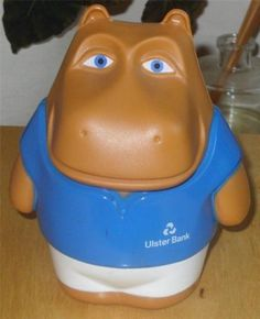 henry the hippo = If you joined Ulster Bank's junior savings club in the eighties you were rewarded with an Henri Hippo money box, along with an assortment of other branded goodies; a wallet, a calendar, pencils etc. Money Box, The Good Old Days, Piggy Bank, Nostalgia, Goodies, Childhood, The Originals, Creative Writing, Irish