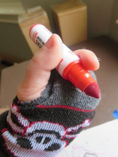 *cut two holes in a lonely sock to help with pencil grasp! why didn't I think of this, thank you for this idea -JT