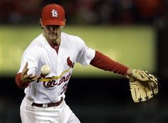 St. Louis Cardinals shortstop Pete Kozma bobbles a ball hit for a single by Cincinnati Reds' Drew Stubbs during the third inning of a baseball game, Monday, Oct. 1, 2012, in St. Louis.