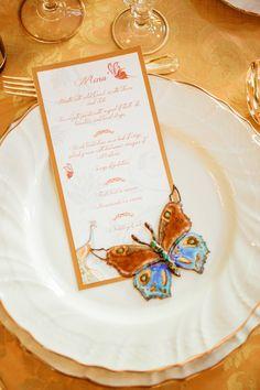 Gold wedding reception menus with butterfly accent via http://www.weddingchicks.com/2014/02/12/let-them-eat-cake-wedding-ideas/