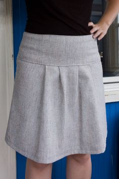 I would absolutely keep the yoke, but instead of regular pleats I'd use a double, or even a single, box pleat.