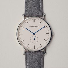 Our Classic Glencoe watch featuring an ultra-thin case, Swiss quartz movement and a unique tweed strap. Minimalist white dial with silver hands and silver case. Dark grey tweed strap with genuine Cool Watches, Watches For Men, Look Fashion, Mens Fashion, Herren Chronograph, Beautiful Watches, Luxury Watches, Fashion Watches, Unisex