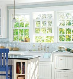 windows + marble detail +  white paneling in kitchen