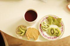 Rice cakes w peanut butter and avocado, kiwi, blueberry/banana smoothie