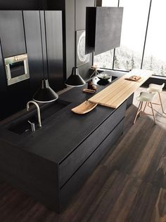 Love the black island with the natural wood breakfast bar