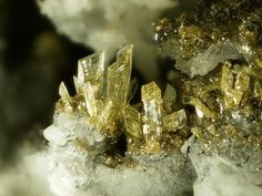 Hephaistosite, TlPb2Cl5, La Fossa crater, Vulcano Island, Lipari, Eolie Islands, Messina Province, Sicily, Italy. Group of tabular and elongated pale yellow crystals of hephaistosite  up to 1 mm. Copyright: © D. Preite - E.B.