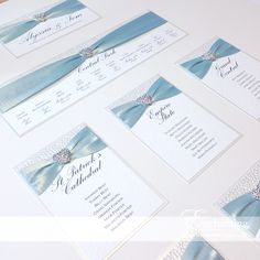 Ice Blue Wedding Stationery | The Ariel Collection - Table Plan / Seating Chart | Featuring white pebble paper, ice blue ribbon and diamante heart embellishment | Luxury handmade wedding invitations and stationery #byenchanting