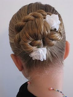 Loop & Twisted Bun...love most of the styles on this site.  Some I could wear, most for kids