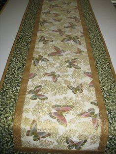 Check out this item in my Etsy shop https://www.etsy.com/listing/470929591/butterfly-table-runner-metallic-fabric
