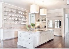 Sophisticated open shelving in a white kitchen.