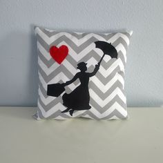 Flying Mary Poppins Heart Pillow on grey and cream chevron fabric.