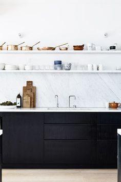 High contrast kitchen - stunning marble splashback against black units