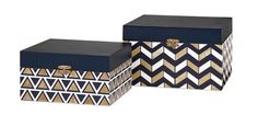 Crisp geometric patterns in navy, gold and cream motifs with a painted and decorative lidded boxes with metal clasps. I Shop Must-Have accessories at Rug & Home I