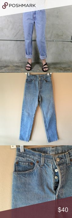 """Vintage Levi's 561 button fly high waisted jeans Vintage Levi's 561 button fly high waisted boyfriend mom jeans. Unique stone/light wash. Patch serial number is """"26561-0154"""" Tag says size 11. Go by measurements, as vintage sizing is off. Waist 13"""" across, inseam 29"""", rise 11.5"""", hips 19"""", leg opening 6.5"""". Boot cut. Little fading in some areas. This is a vintage item. Sold as is! Levi's Jeans Boyfriend"""
