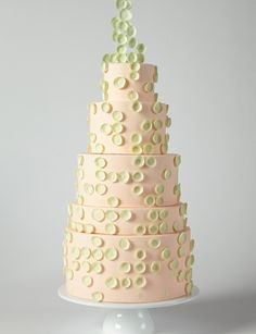 Whimsical pale pink cake with pale green circles.