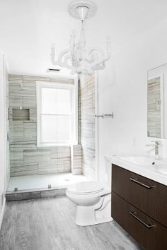 Traditional 3/4 Bathroom with Hardwood floors, frameless showerdoor, Limestone counters, Pendant Light, Undermount Sink