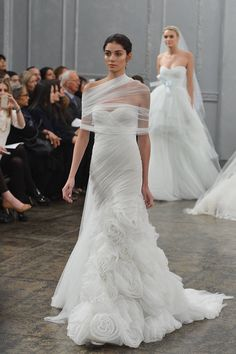 Monique Lhuillier: may seem little extravagant for otherwise understated bride, but it's wedding day! top of dress will show off curves perfectly, & bottom will allow her to feel extra fanciful; also absolutely adore way Monique Lhuillier styled tulle shawl