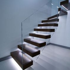 Floating stairs in dark finish. Led lights under each tread with opti- white glass balustrade. Floating stairs in dark finish. Led lights under each tread with opti- white glass balustrade. Glass Stairs, Concrete Stairs, Glass Stair Railing, Wood Stairs, Basement Stairs, Railings, Rustic Stairs, Modern Stairs, Cantilever Stairs