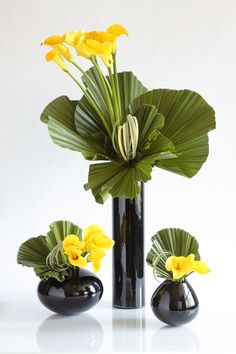 Modern yellow arrangements.  Remember those black vases I showed you? @Lauren Davison Davison Davison Jackson