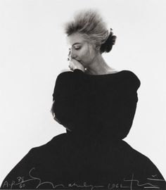 Marilyn Monroe, the last session shot taken of her by Bert Stern.  He was shooting her for Vogue, and ran out of film.  He told her to take five.  She stood in front of a window, and when he peeked around the corner he saw this.  Instead of the photo being used inside Vogue magazine as a feature it was used for her obit 6 weeks later.  I love it.  What was she thinking...