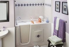 Sit Down Bathtub Design Sitdown With Fibergl Material Featuring Cream Colored Wall Tile And Br Hanger Purple Towel Plus Black