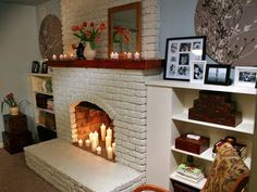 Reminds me of my old fireplace. I love the painted brick and bookcases.