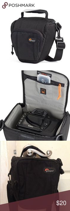 Lowepro Toploader Zoom 45 Camera Case Like new. Was too small for what I needed. Fits a DSLR with attached lens (up to 18-55mm f/3.5), memory card and accessories Patented, built-in All Weather AW Cover protects gear from the elements.Easy-access lid with dual zipper pulls opens away from body and provides full access to gear.SlipLock attachment loop expands carrying capacity Fully padded interior protects gear; horizontal divider allows storage of extra lens in main compartment Lowepro Bags…