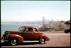 And Charles Cushman had to take a photograph of his new coupe beside the recently-completed Golden Gate Bridge.