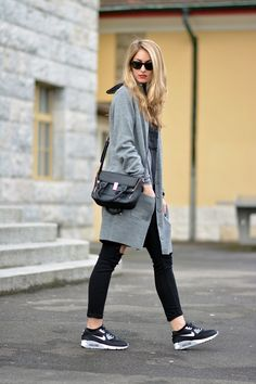 Shop this look on Lookastic: https://ca.lookastic.com/women/looks/cardigan-crew-neck-t-shirt-skinny-jeans-athletic-shoes-satchel-bag-sunglasses/9229   — Grey Cardigan  — Black Sunglasses  — Charcoal Print Crew-neck T-shirt  — Black Leather Satchel Bag  — Black Ripped Skinny Jeans  — Black and White Athletic Shoes