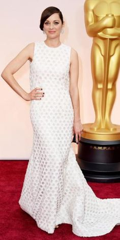 Marion Cotillard in a white sleeveless Christian Dior Haute Couture bustled gown.