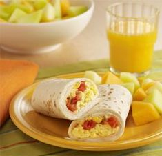 Easy Breakfast Burritos... This breakfast burrito recipe filled with scrambled Egg Beaters, spicy tomatoes and cheese can be prepared in just 15 minutes