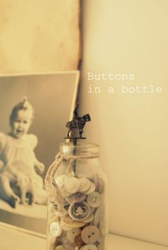Misses Brocant buttons in a bottle