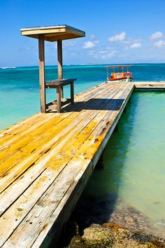 Rodger's Dock by: Ryan Burton lonely boat on a beautiful dock at Rodger's beach in Aruba in the Caribbean ocean.