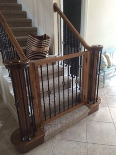 We moved in to our house last year and really did not use the upstairs much because we did not have kids. At the time our kids were our dogs and they liked to run up and down the stairs. So the search for a dog gate that would work on our stairs. Diy Dog Gate, Diy Baby Gate, Pet Gate, Dog Gates, Baby Gate For Stairs, Stair Gate, Stair Railing, Staircase Gate, Stairway