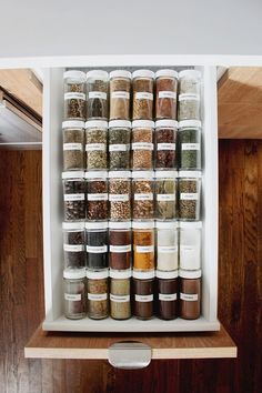 "i have always fantasized about having organized spices, and i'm so happy i made those dreams come true. we installed a small drawer next to our stove and i just took a few hours to transfer all our miscellaneous spices into matching containers. so worth it. and because our spices have always been a disaster, i've never … Continue reading ""spice drawer organization"" #kitchendecor #kitchenorganizing Kitchen Organization Pantry, Spice Organization, Home Organisation, Kitchen Storage, Pantry Ideas, Spice Storage, Organized Kitchen, Spice Racks, Spice Drawer Organizer"
