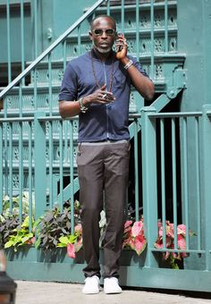 Wear a navy cotton bomber jacket and grey chinos for knockout menswear style. Inject a dose of stylish casualness into your outfit by finishing with a pair of white low top sneakers. Michael K Williams, Kenneth Williams, Grey Chinos, Best Dressed Man, African American Men, Comme Des Garcons, Gentleman Style, Gray Jacket, Men Looks