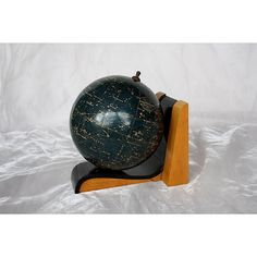 Decorative Globe Bookend ($495) ❤ liked on Polyvore featuring home, home decor and small item storage