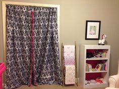 Removed closet doors & hung drapes with pink trims