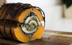 Behold! The vegducken. This multi-layered holiday entrée features zucchini, eggplant, mushrooms, and homemade stuffing all enclosed in a roasted butternut squash.