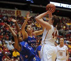 Iowa State's Bryanna Fernstrom shoots over Kansas' Aisia Robertson, left, and Tyler Johnson on Saturday at Hilton Coliseum. Photo by Nirmalendu Majumdar/Ames Tribune  http://amestrib.com/sports/women-s-basketball-notebook-free-throw-struggles-continue-against-kansas