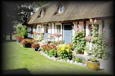 THIS looks like the old 1900 pics of Denmark that my Grandparents had!  A typical old-style house and front garden in Denmark.