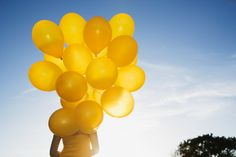 75780310-bunch-of-yellow-balloons-on-string-against-gettyimages.jpg 507×338…